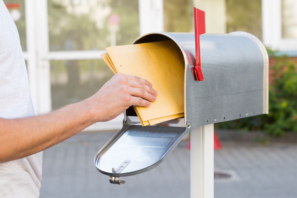 A man checking his mail